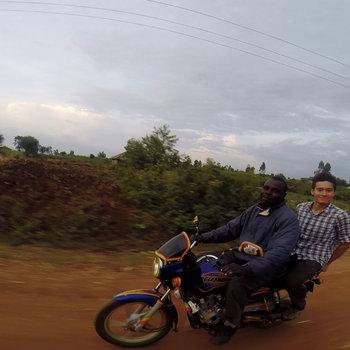 Watsi - Thomas on a moto.