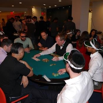 "LiveIntent - We work hard, but sometimes it's ""all fun & games."" LiveIntenters try their luck during casino night in the office."