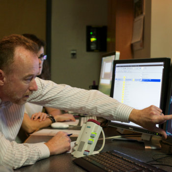 Cambridge Brain Sciences - Adrian, scanning a patient.