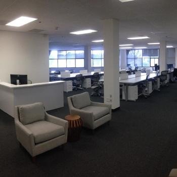 UserCare - The interior of our modern office with Herman MIller chairs and adjustable standing/sitting desks