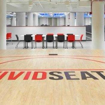 Vivid Seats LLC - Our kitchen area features a basketball key & doubles as a stage