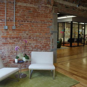 ECMC - We're housed in a historic building in the Mt. Vernon neighborhood of Washington DC. We've designed our space to be open and modular for multiple work styles.