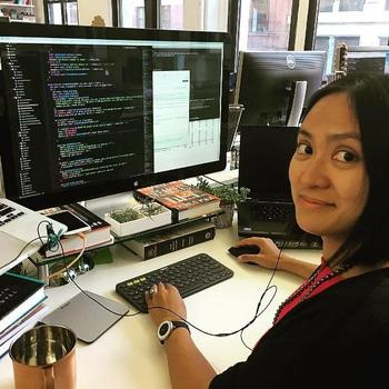 Book of the Month - Full-stack Engineer Bianca coding up an email refresh on her new computing rig.