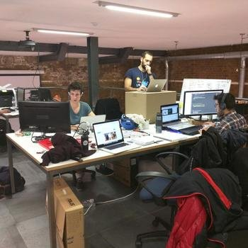 Xihelm Limited - We work in a cool former biscuit factory. You can even use boxes as standing desks like Kostas.