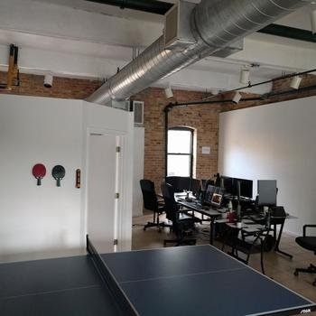 Intelligent Flying Machines, Inc. - We have a 2 story office loft with our own warehouse space, Makerspace, office space, bean bags, sofa, ping pong and sleeping room. Also, there are drones all over this place.
