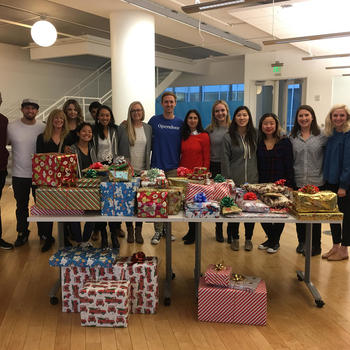 Opendoor - Team members hosted a wrapping party after participating in the Mercy Housing Holiday Gift Drive.