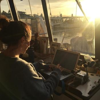 Successful Business Co - Here's the CEO, working from a houseboat, photo taken by the product manager who was also working on the houseboat.