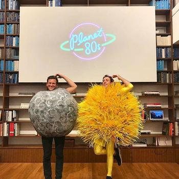 """Warby Parker - Our co-CEOs Neil Blumenthal and Dave Gilboa borrowed the costumes from our """"Solar Eclipse of the Heart"""" video for our Planet 80's-themed #teamwarby outing 🌚🌞"""