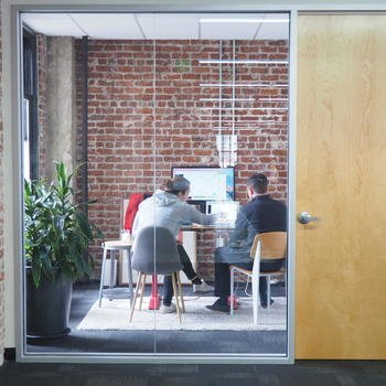 Even - Our sunny space in downtown Oakland offers an open-floor workspace and small group offices