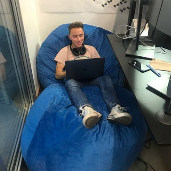 Pray.com - iOS engineer Shaun coding away on some of the office bean bags
