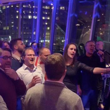 "Skyhook Wireless - Skyhook Holiday Party 2018's ensemble finale performance of Journey's ""Don't Stop Believin'"""