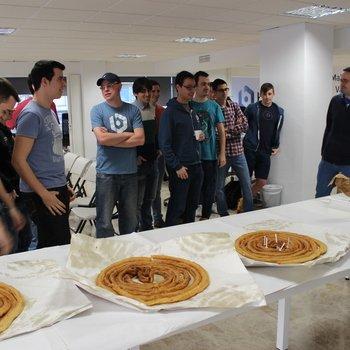 Bitnami - We like to celebrate! Here we're eating birthday churros in our Spanish office.