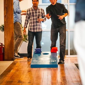 SingleStore - Happy hour / game of corn hole in the office