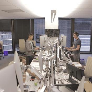 Outcome Health - Open layout, standing desks and monitors for days